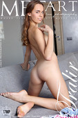 Gracie - Gracie shows off her petite body and trimmed pussy on the sofa.