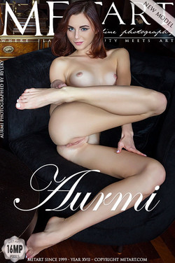 Newcomer Aurmi displays her sexy, tight body and sweet pussy on the couch.